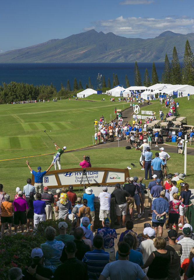 Photo - Adam Scott, of Australia, tees off on the first tee during the third round of the Tournament of Champions golf tournament, Sunday, Jan. 5, 2014, in Kapalua, Hawaii.  (AP Photo/Marco Garcia)