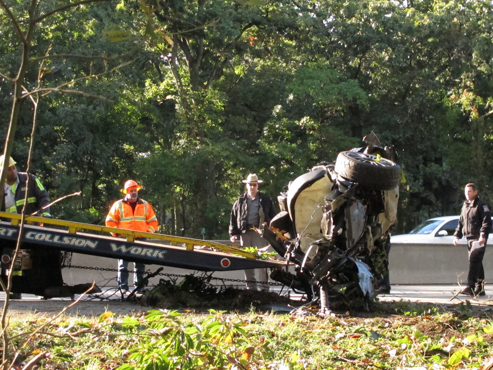 Photo -   Wreckage from a one-car fatal crash is loaded onto a flatbed truck on the Southern State Parkway in West Hempstead, N.Y., Monday, Oct. 8, 2012. New York State Police say four people were killed in the early Monday accident on Long Island. The westbound lanes of the parkway were closed between exits 17-19. Police say a fifth person was taken to a hospital. (AP Photo/Frank Eltman)