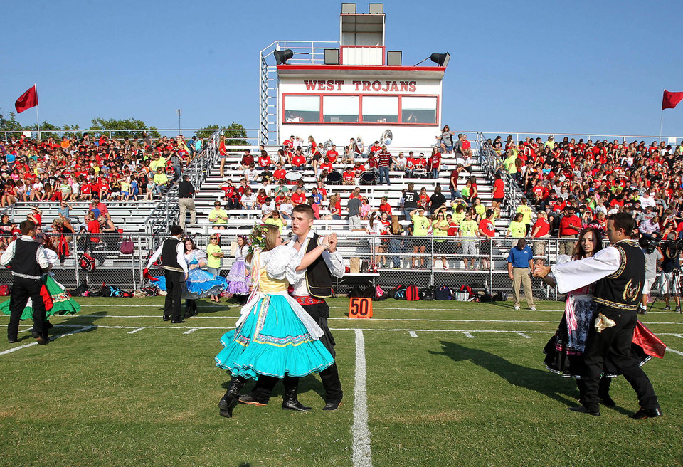 The West High School Junior Historian Czech Dancers performs on Thursday, Aug. 29, 2013, at a morning pep rally in West, Texas. The West Trojans football team opens the season Thursday night on their field that was used as a triage site when West Fertilizer Plant exploded on April 17, where 15 people died. (AP Photo/ Waco Tribune Herald, Jerry Larson)