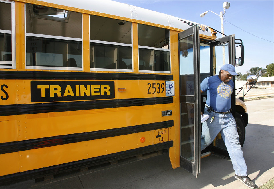 Photo - Bus driver trainees get off a school bus  while training at the district's transportation center in northeast Oklahoma City, Thursday,  Aug. 7, 2008.   BY JIM BECKEL, THE OKLAHOMAN