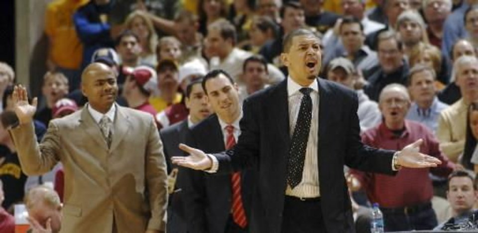 Photo - Oklahoma head coach  Jeff  Capel, right, argues a call during the second half of an NCAA college basketball game against Missouri Wednesday, March 4, 2009, in Columbia, Mo. Missouri won the game 73-64. (AP Photo/L.G. Patterson)