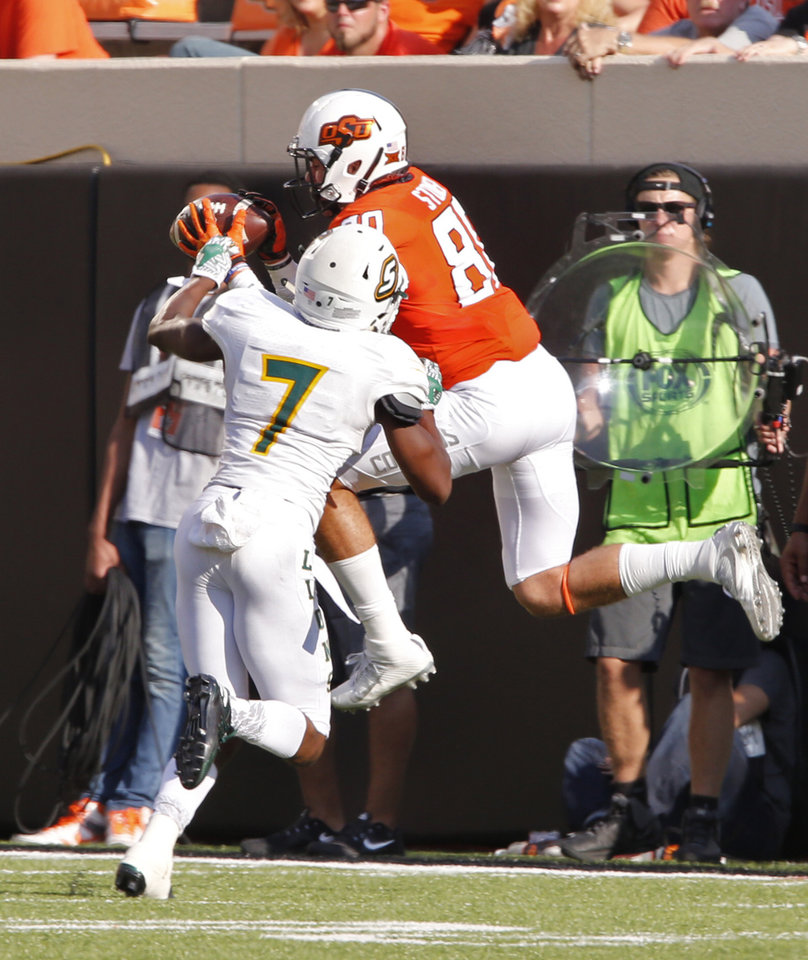 Photo - Oklahoma State's Dillon Stoner (80) catches a pass for a first down in front of Louisiana's Torrance Mosley (7) during the second half of a college football game between the Oklahoma State Cowboys (OSU) and the Southeastern Louisiana Lions at Boone Pickens Stadium in Stillwater, Okla., Saturday, Sept. 12, 2015. Photo by Steve Sisney, The Oklahoman