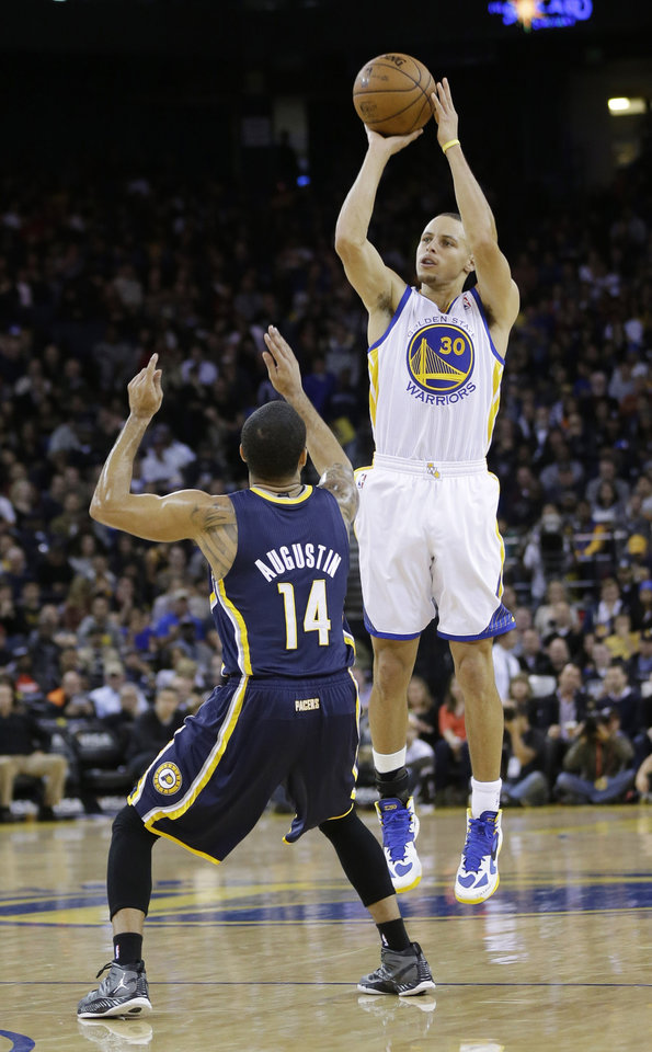 Golden State Warriors' Stephen Curry (30) shoots over Indiana Pacers' D.J. Augustin (14) during the first half of an NBA basketball game in Oakland, Calif., Saturday, Dec. 1, 2012. (AP Photo/Marcio Jose Sanchez)