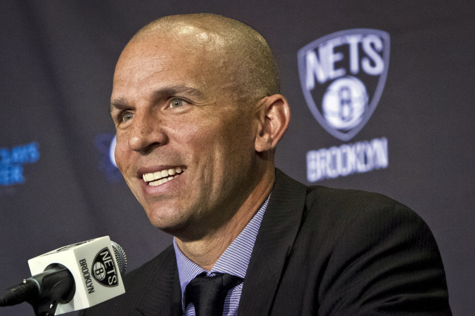 Photo - Brooklyn Nets new head coach Jason Kidd smiles as he is introduced during an NBA basketball news conference Thursday, June 13, 2013, in  New York.   (AP Photo/Bebeto Matthews)