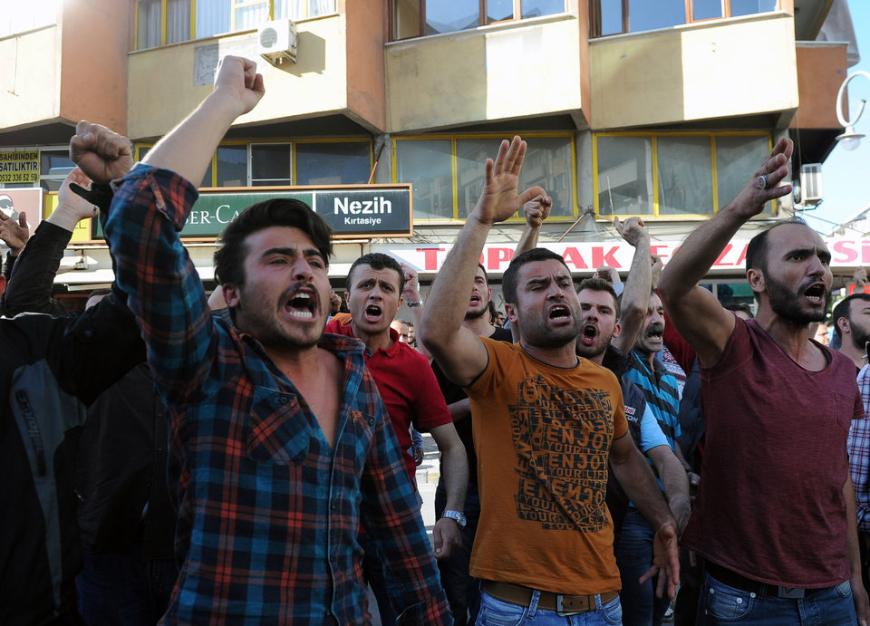 Photo - Demonstrators shout anti-government slogans during a protest against the government in Soma, Turkey, Friday, May 16, 2014. A Turkish mining company defended its safety record Friday, four days after over 250 people died in an underground blaze at its coal mine in western Turkey. (AP Photo/Emre Tazegul)