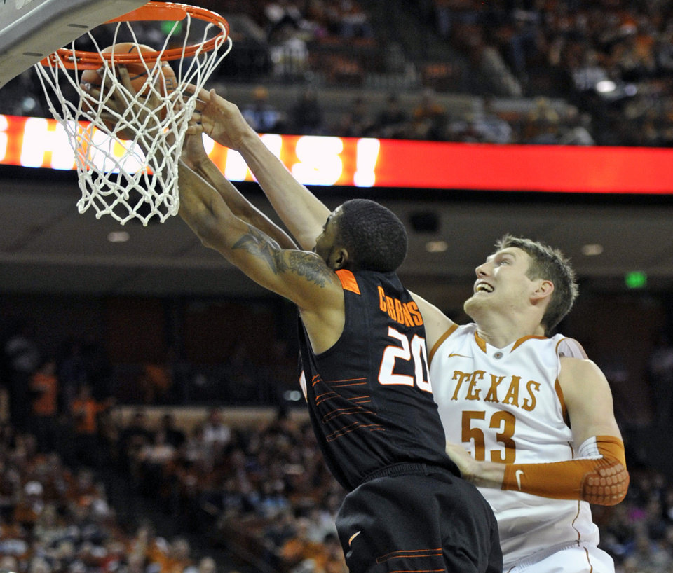 Photo - Texas center Clint Chapman (53) blocks a shot by Oklahoma State forward Michael Cobbins during the first half of an NCAA college basketball game Saturday, Jan. 7, 2012, in Austin, Texas. (AP Photo/Michael Thomas) ORG XMIT: TXMT106