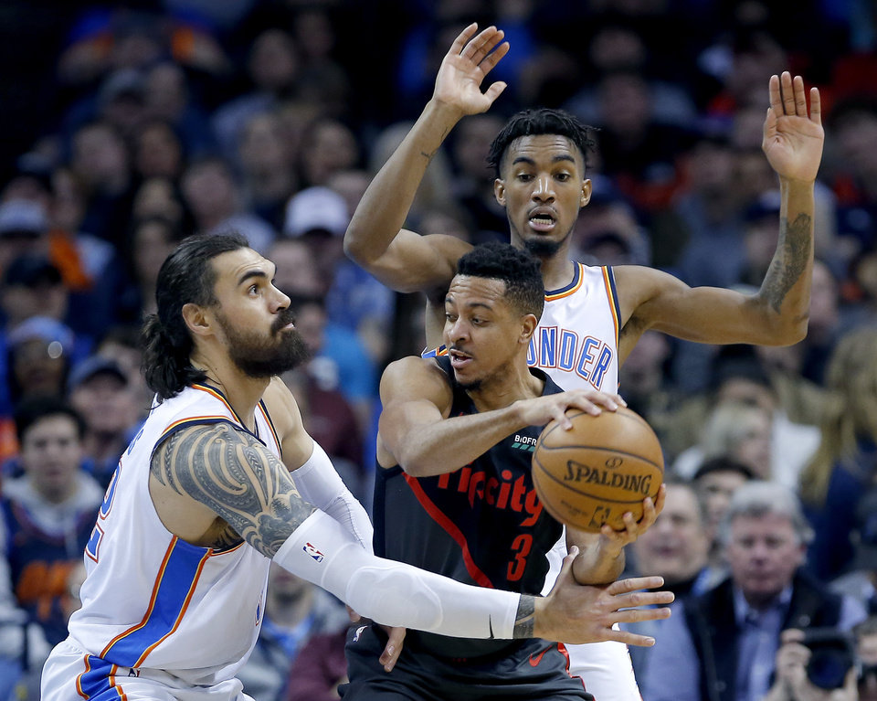 Photo - Oklahoma City's Steven Adams (12) and Terrance Ferguson (23) defends against Portland's CJ McCollum (3) during the NBA basketball game between the Oklahoma City Thunder and the Portland Trail Blazers at Chesapeake Energy Arena in Oklahoma City, Tuesday, Jan. 22, 2019. Photo by Sarah Phipps, The Oklahoman
