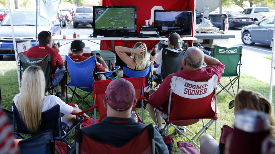 Tailgaters watch the OSU game on television before the college football game where the University of Oklahoma Sooners (OU) play the University of Louisiana Monroe Warhawks at Gaylord Family-Oklahoma Memorial Stadium in Norman, Okla., on Saturday, Aug. 31, 2013. Photo by Steve Sisney, The Oklahoman