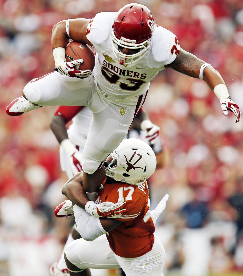 UT's Adrian Phillips (17) brings down OU's Trey Millard (33) in the first quarter during the Red River Rivalry college football game between the University of Oklahoma Sooners and the University of Texas Longhorns at the Cotton Bowl Stadium in Dallas, Saturday, Oct. 12, 2013. Photo by Nate Billings, The Oklahoman