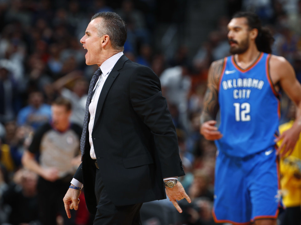 Photo - Oklahoma City Thunder coach Billy Donovan argues for a call during the first half of the team's NBA basketball game against the Denver Nuggets on Thursday, Nov. 9, 2017, in Denver. (AP Photo/David Zalubowski)