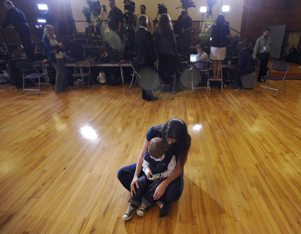 Photo - Allison Scott and her son, Mateo Scott, 2, wait for former Pennsylvania Sen. Rick Santorum, before a South Carolina Republican presidential primary night rally at The Citadel, Saturday, Jan. 21, 2012, in Charleston, S.C. (AP Photo/Rainier Ehrhardt) ORG XMIT: SCRE105