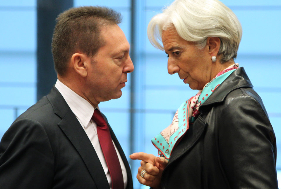 Photo -   Greek Finance Minister Yannis Stournaras , left, talks with International Monetary Fund managing director Christine Lagarde, during the Eurogroup meeting, in Luxembourg, Monday Oct. 8, 2012. Finance ministers from the nations sharing the euro currency assess the latest developments in the financial crisis. (AP Photo/Yves Logghe)