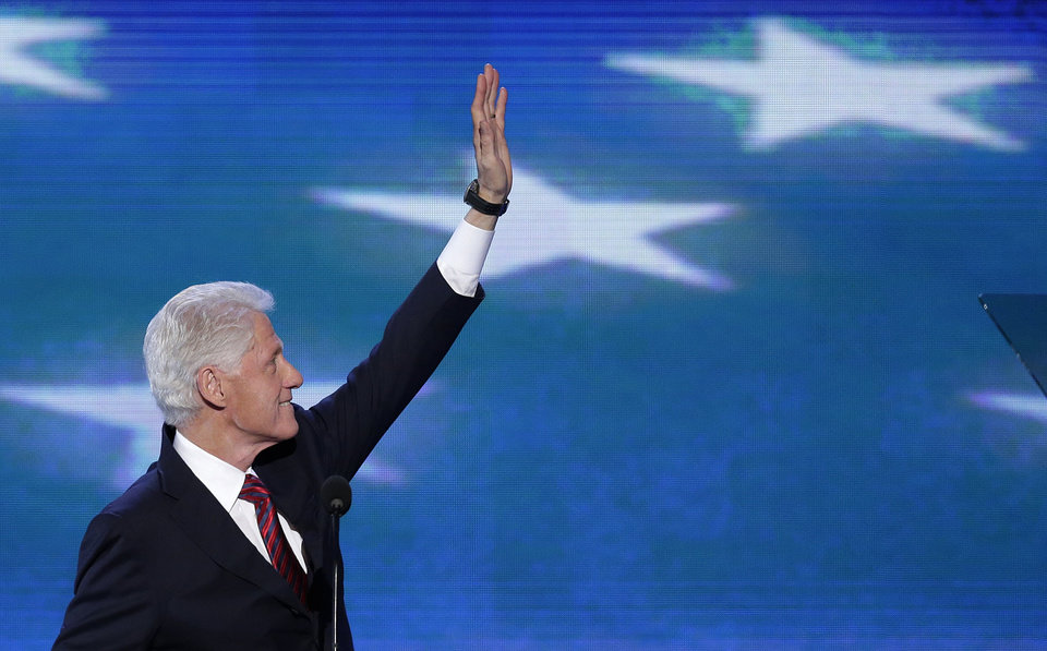 Photo - Former President Bill Clinton waves to the delegates before addressing the Democratic National Convention in Charlotte, N.C., on Wednesday, Sept. 5, 2012. (AP Photo/J. Scott Applewhite)  ORG XMIT: DNC176