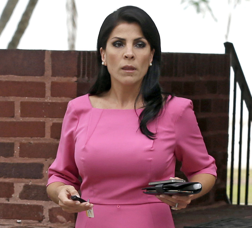 FILE - In this Nov. 13, 2012, file photo, Jill Kelley leaves her home in Tampa, Fla. The way the FBI responded to Jill Kelley�s complaint about receiving harassing emails, which ultimately unraveled or scarred the careers of ex-CIA Director David Petraeus and Marine Gen. John Allen, is the exception, not the rule. The FBI commonly declines to pursue cyberstalking cases without compelling evidence of serious or imminent harm to an individual, victims of online harassment, advocacy groups and computer crime experts told The Associated Press. (AP Photo/Chris O'Meara, File)