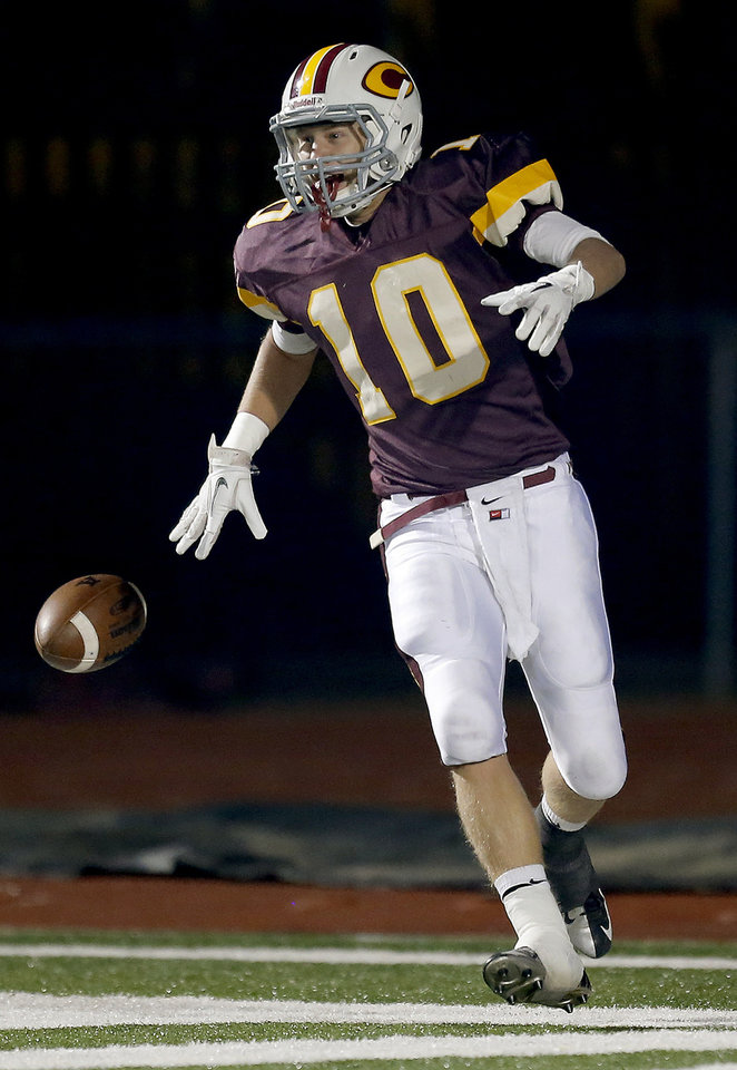 Clinton\'s Quinton Hand celebrates an interception for touchdown during the high school playoff game between Ada and Clinton at Putnam City High School in Oklahoma City, Friday, Nov. 23, 2012. Photo by Sarah Phipps, The Oklahoman