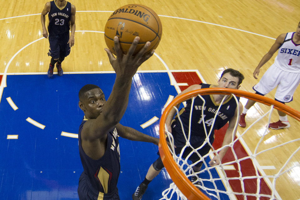 Photo - New Orleans Pelicans' Anthony Morrow  goes up for the shot with Jason Smith looking on during the third quarter of an NBA basketball game against the Philadelphia 76ers, Friday, Nov. 29, 2013, in Philadelphia.  The Pelicans win 121-105.  (AP Photo/Chris Szagola)