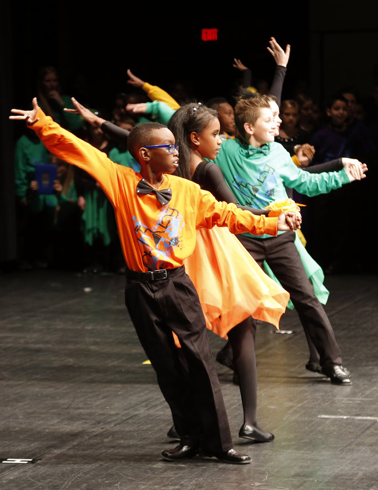 Photo -  Ridgeview Elementary School's Keshaun James and Noel Warrior perform the cha-cha during the LifeChange Ballroom competition at the Rose State Performing Arts Theatre in Midwest City. Photo by Sarah Phipps, The Oklahoman   Sarah PHIpps -  Sarah Phipps