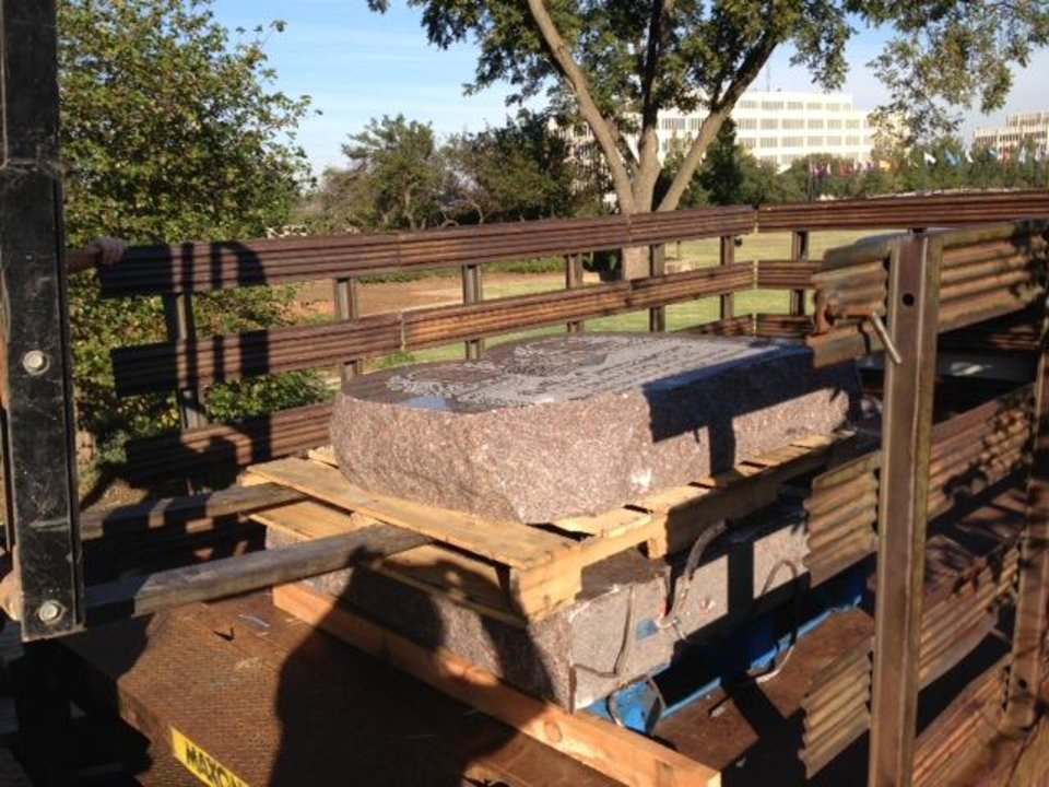 Photo -  Pieces of the Ten Commandments monument are hauled away Friday after they were toppled Thursday evening. Photo by Barbara Hoberock, Tulsa World