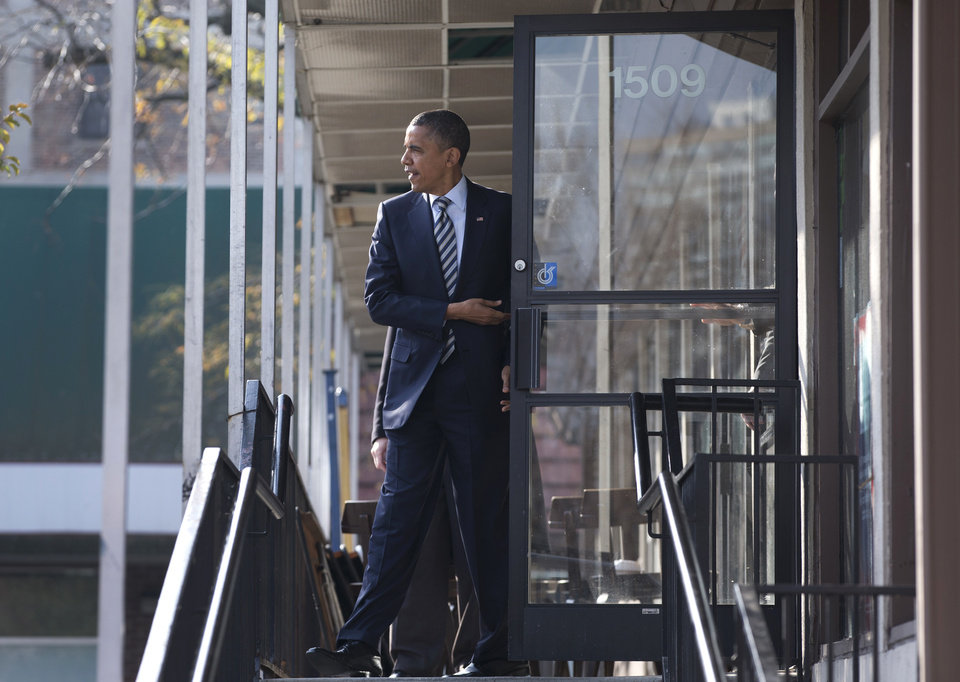 Photo -   President Barack Obama leaves a campaign office the morning of the 2012 election, Tuesday, Nov. 6, 2012, in Chicago, after visiting with volunteers, making phone calls and speaking to the media. (AP Photo/Carolyn Kaster)
