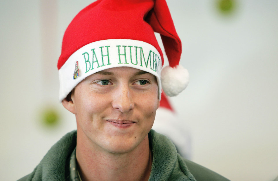 "Photo - Above: Pvt. Braden Cupples wears a ""Bah Humbug"" hat Friday at the Myriad Botanical Gardens."