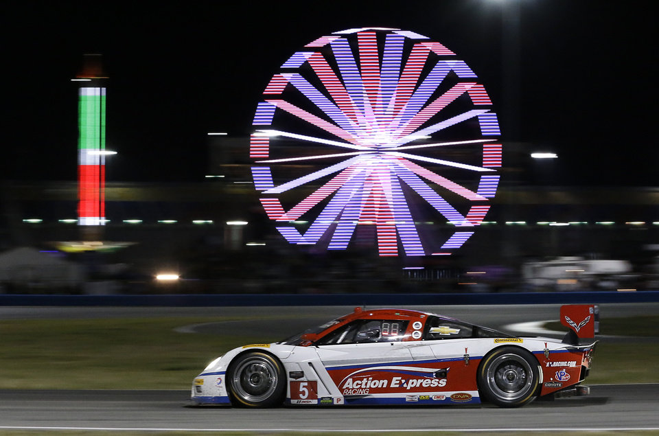 Photo - Christian Fittipaldi, of Brazil, drives the Action Express Racing Corvette DP to the horseshoe turn in the IMSA Series Rolex 24 hour auto race at Daytona International Speedway in Daytona Beach, Fla., Saturday, Jan. 25, 2014. (AP Photo/John Raoux)