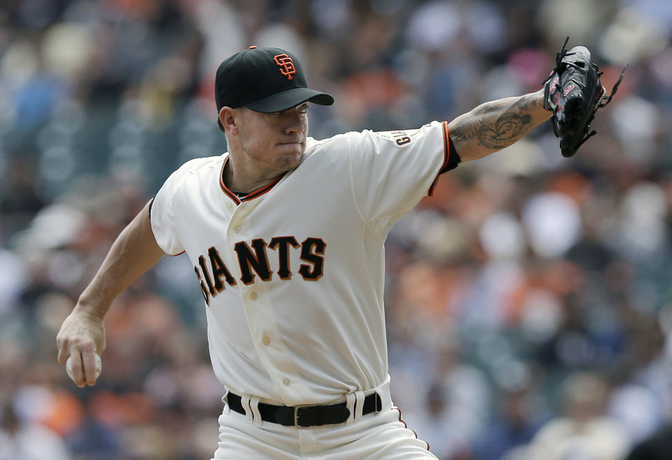 Photo - San Francisco Giants pitcher Jake Peavy throws against the Chicago White Sox during the first inning of a baseball game in San Francisco, Calif., Wednesday, Aug. 13, 2014. (AP Photo/Jeff Chiu)