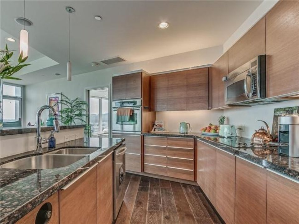 Photo -  Kitchen of the Listing of  the Week, a condo in The 360 at Founders Plaza, 5900 Mosteller Drive, No. 92. [PHOTO PROVIDED]