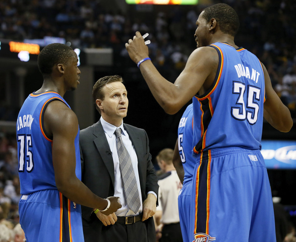 Photo - Oklahoma City coach Scott Brooks talks with Reggie Jackson (15) and Kevin Durant (35) during Game 3 in the second round of the NBA basketball playoffs between the Oklahoma City Thunder and Memphis Grizzles at the FedExForum in Memphis, Tenn.,  Saturday, May 11, 2013. Memphis won, 87-81. Photo by Nate Billings, The Oklahoman