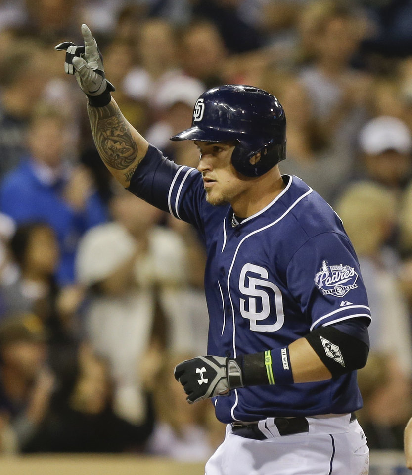 San Diego Padres' Yasmani Grandel celebrates his three run homer against the Arizona Diamondbacks in the Padres' five run fourth inning in a baseball game Saturday, June 15, 2013, in San Diego. (AP Photo/Lenny Ignelzi)