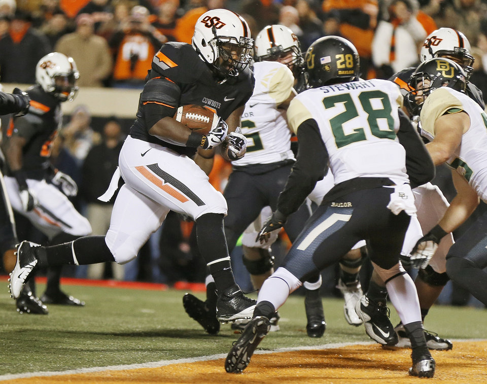 Oklahoma State's Kye Staley (9) rushes for a touchdown in the first quarter during a college football game between the Oklahoma State University Cowboys (OSU) and the Baylor University Bears (BU) at Boone Pickens Stadium in Stillwater, Okla., Saturday, Nov. 23, 2013. Photo by Nate Billings, The Oklahoman