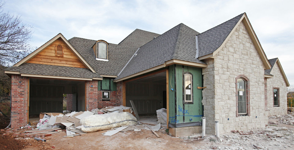 Photo - A home by Benjamin Floyd Homes is seen under construction on Acorn Drive in Edmond's Oak Tree neighborhood. Photo by David McDaniel, The Oklahoman