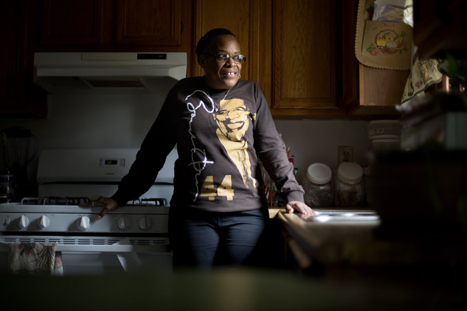Photo - This Jan. 2, 2013, photo, shows Victoria Wimberley, who will be attending President Barack Obama's inauguration for the second time, standing in the kitchen of her home in Decatur, Ga. Four years and one re-election after his historic oath-taking as America's first black president, some of the thrill for Barack Obama is gone. Wimberley brought four busloads of people to Washington for the 2009 inauguration. She's coming again this month, though with two fewer buses, which she blamed on the high price for accommodations, not any lack of excitement for Obama. (AP Photo/David Goldman)