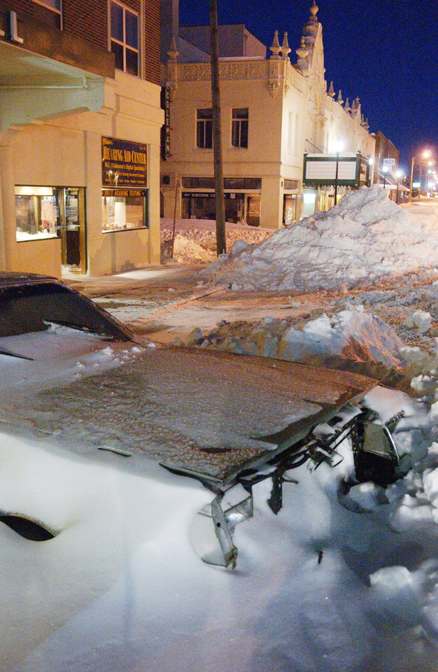 Photo - Abandoned car on Main Street in Miami, Okla., Wednesday, Feb. 2, 2011, after the blizzard dropped 20 inches of snow Tuesday. Gary Crow, for the Oklahoman