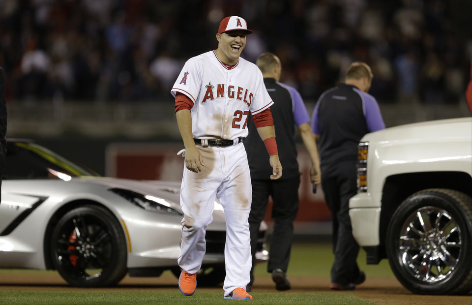 Photo - American League's Mike Trout, of the Los Angeles Angels, reacts after winning the MVP Award at the MLB All-Star baseball game, Tuesday, July 15, 2014, in Minneapolis.  (AP Photo/Jeff Roberson)