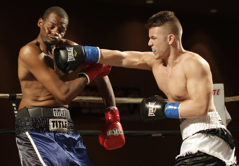 Bo Gibbs Jr. (right), of Oklahoma City, fights Lyle Barron, of Oklahoma City, at the Cox Convention Center in Oklahoma City, Thursday, Sept. 20, 2012.  Photo by Garett Fisbeck, The Oklahoman