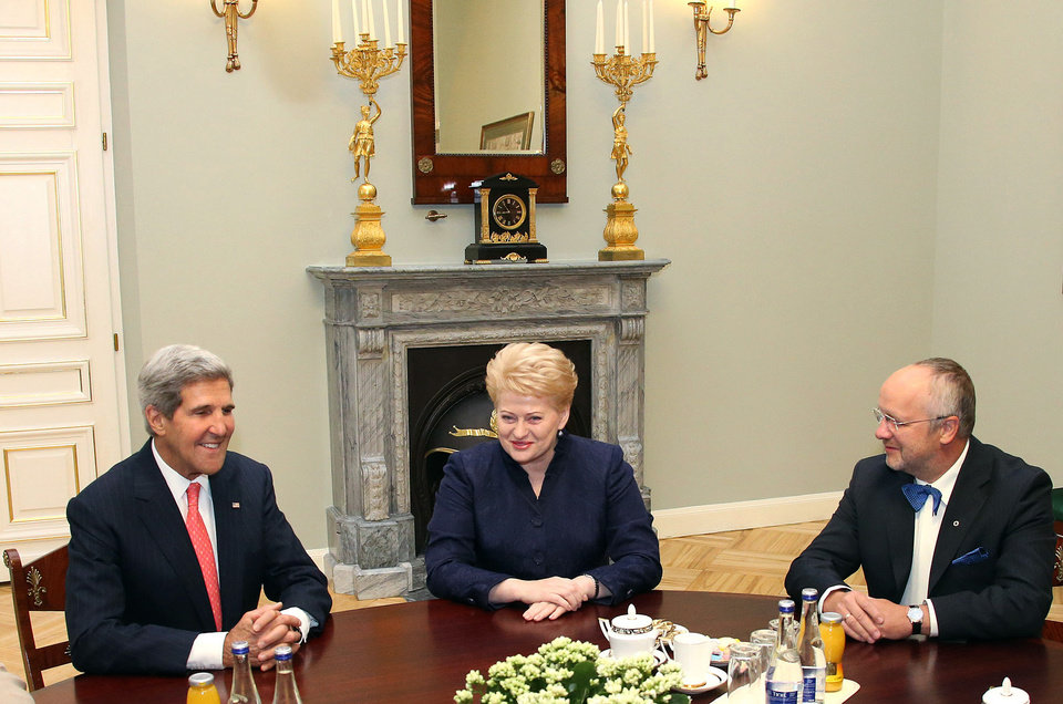 Photo - This photo made available by the Lithuanian Presidential Press Service shows United States Secretary of State John Kerry, left, speaking to Lithuania's President Dalia Grybauskaite, center, and Lithuania's Minister of Defence Juozas Olekas, right, prior to their meeting at the President palace in Vilnius, Lithuania, Saturday, Sept. 7, 2013. Kerry is in Europe courting international support for a possible U.S. strike on the Syrian regime for its alleged use of chemical weapons.  (AP Photo/Presidential Press Service, Dzoja Borysaite)