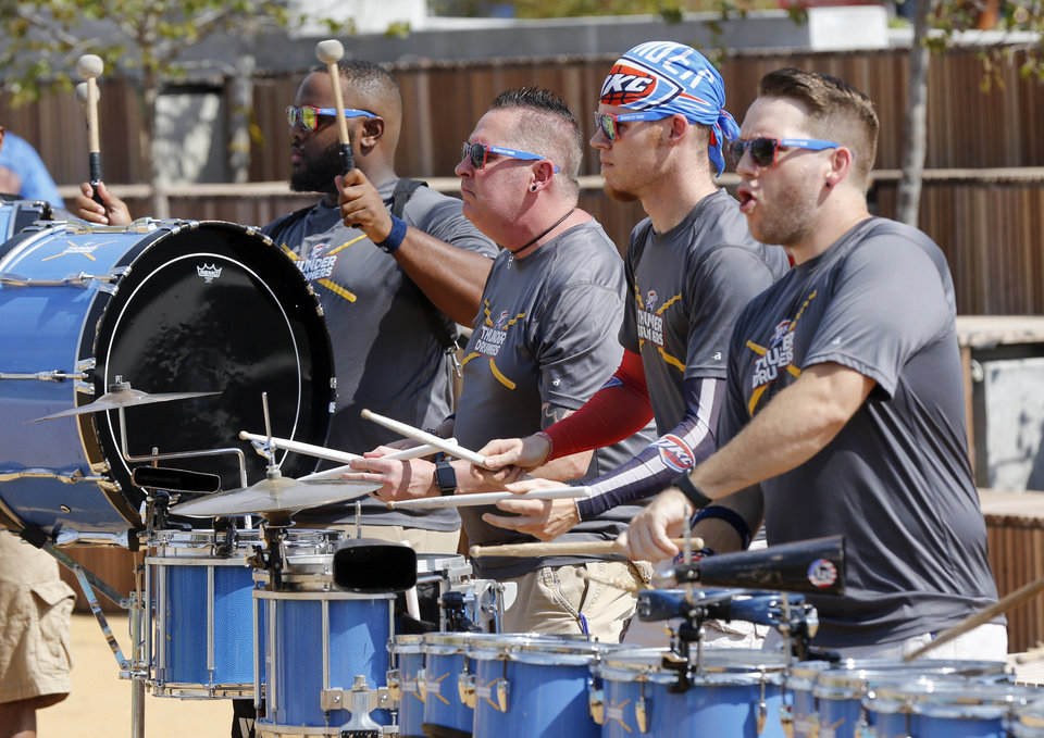 Photo - The Thunder Drummers perform in the children's playground during the grand opening weekend of Scissortail Park in Oklahoma City, Saturday, Sept. 28, 2019. [Nate Billings/The Oklahoman]