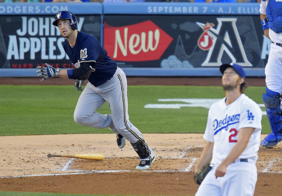 Photo - Milwaukee Brewers' Ryan Braun, left, watches a two-run home run off Los Angeles Dodgers starting pitcher Clayton Kershaw, right, during the fourth inning of a baseball game, Saturday, Aug. 16, 2014, in Los Angeles. (AP Photo/Mark J. Terrill)