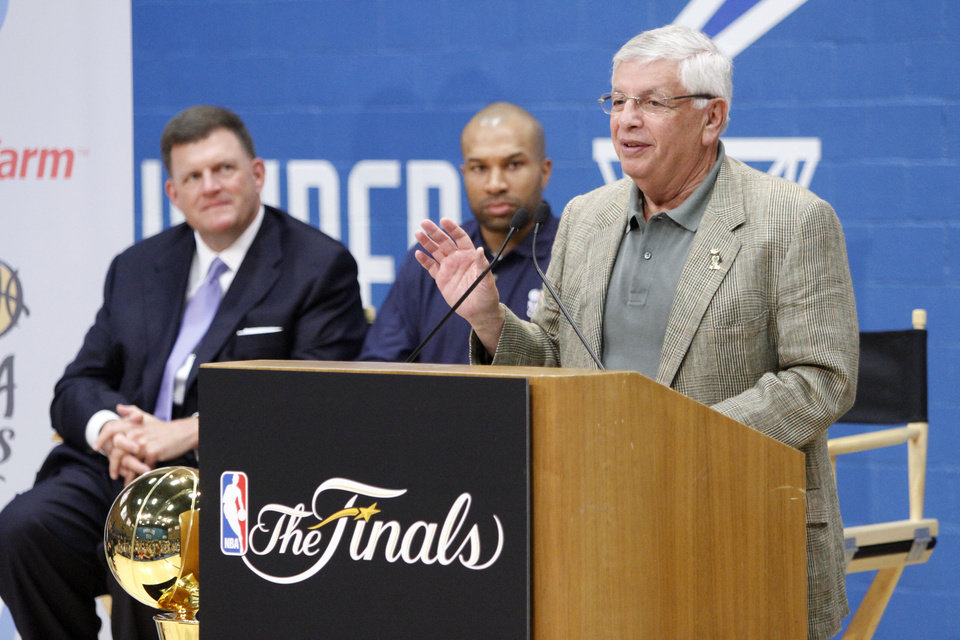 Photo - NBA Commissioner David Stern, speaks  at the opening of the NBA Cares Learn & Play Center at the City Rescue Mission in Oklahoma City. At left is Clay Bennett, Oklahoma City Thunder Chairman and CEO, and Thunder's Derek Fisher. Photo By Steve Gooch, The Oklahoman  Steve Gooch - The Oklahoman