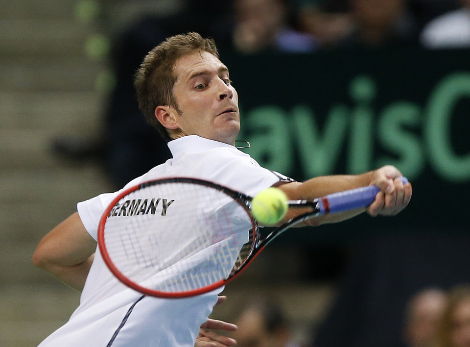 Photo - Germany's Florian Mayer hits a forehand against Spain's Feliciano Lopez during a Davis Cup World Group first round tennis match between Germany and Spain in Frankfurt, Germany, Friday, Jan. 31, 2014. (AP Photo/Michael Probst)