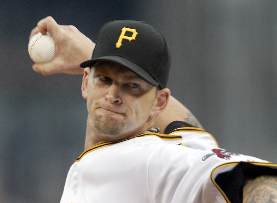 Photo -   Pittsburgh Pirates starting pitcher A.J. Burnett throws against the San Diego Padres in the first inning of a baseball game on Saturday, Aug. 11, 2012, in Pittsburgh. (AP Photo/Keith Srakocic)