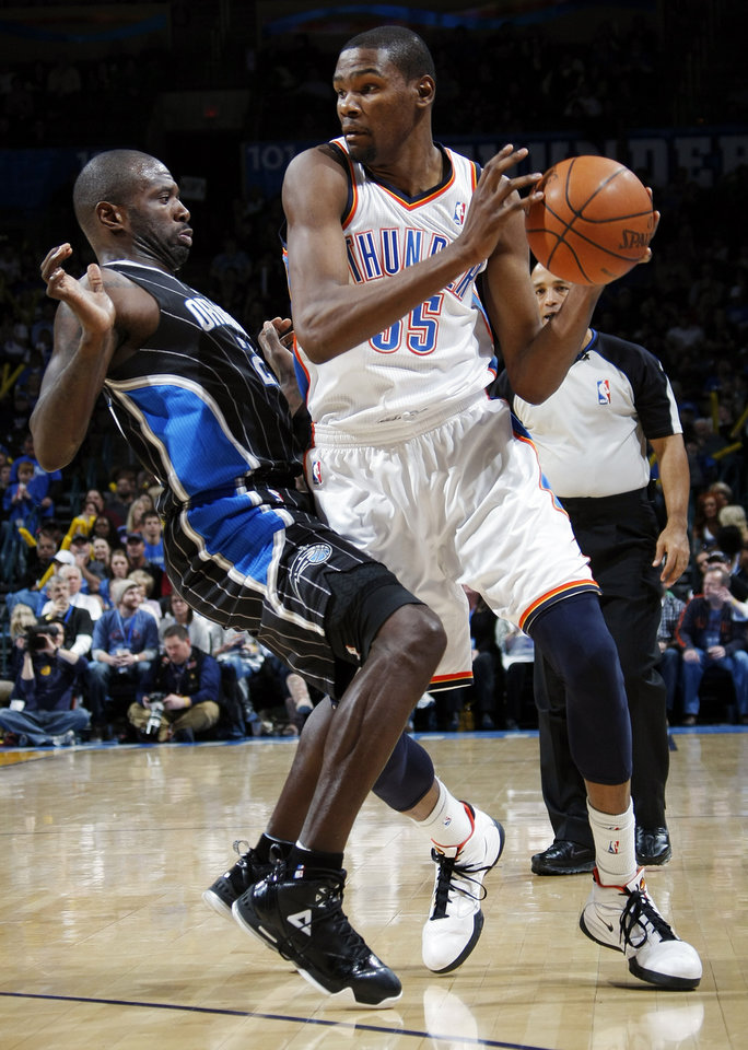 Oklahoma City's Kevin Durant (35) works around the defense of Orlando's Jason Richardson (23) during the NBA basketball game between the Orlando Magic and Oklahoma City Thunder in Oklahoma City, Thursday, January 13, 2011. Oklahoma City won, 125-124. Photo by Nate Billings, The Oklahoman