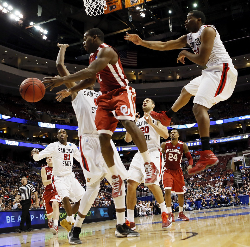 Oklahoma\'s Sam Grooms (1) passes away from the San Diego State defense during a game between the University of Oklahoma and San Diego State in the second round of the NCAA men\'s college basketball tournament at the Wells Fargo Center in Philadelphia, Friday, March 22, 2013. San Diego State beat OU, 70-55. Photo by Nate Billings, The Oklahoman