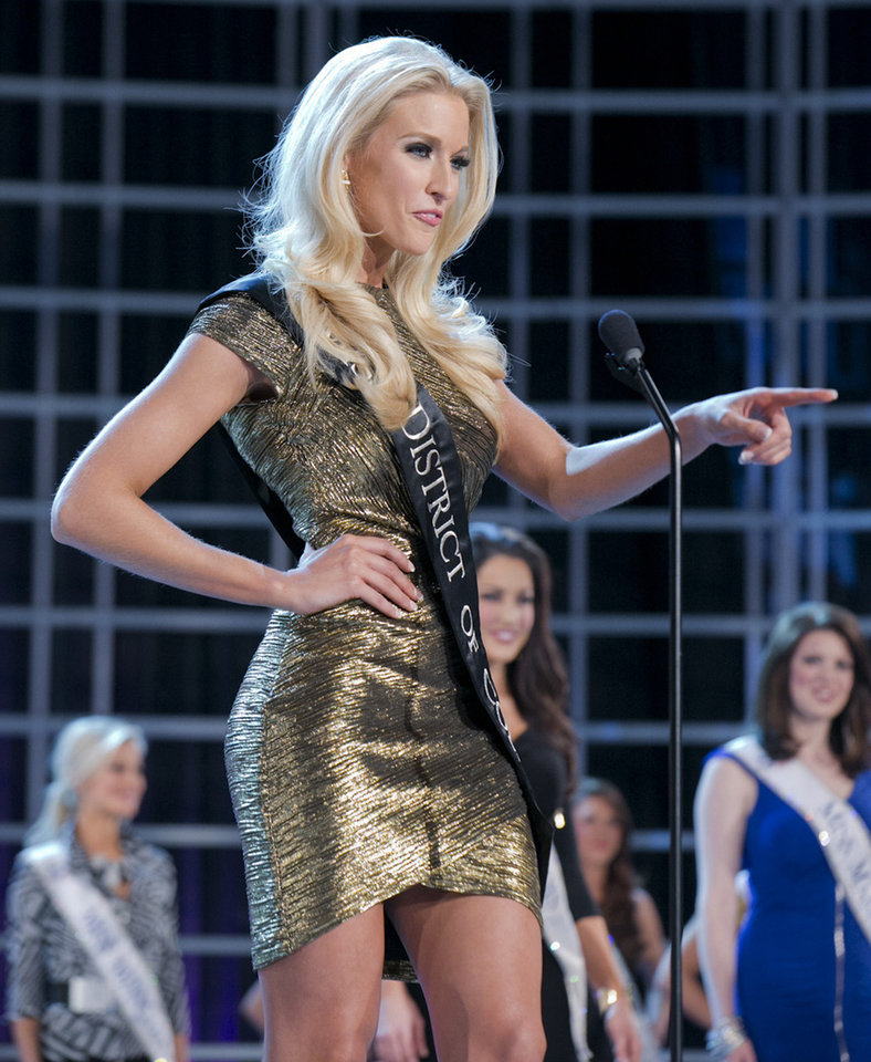 This photo courtesy Miss America Organization shows Miss DC, Allyn Rose, during preliminary competition at the 2013 Miss America Pageant in Las Vegas, Tuesday, Jan. 8, 2013. Win or lose, Saturday\'s Miss America competition will be Rose\'s last pageant. The 24-year-old plans to undergo a double mastectomy after the event as a preventative measure to reduce her chances of developing the disease that killed her mother, grandmother and great aunt. (AP Photo/Courtesy Miss America Organization)