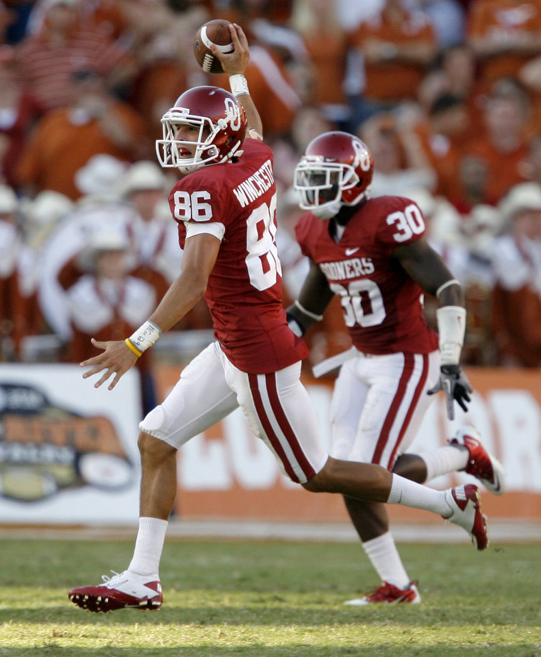 Photo - OU's James Winchester celebrates in front of Javon Harris after a fumble recovery in the fourth quarter of the second half of the Red River Rivalry college football game between the University of Oklahoma Sooners (OU) and the University of Texas Longhorns (UT) at the Cotton Bowl on Saturday, Oct. 2, 2010, in Dallas, Texas. OU defeated Texas 28-20.  Photo by Bryan Terry, The Oklahoman