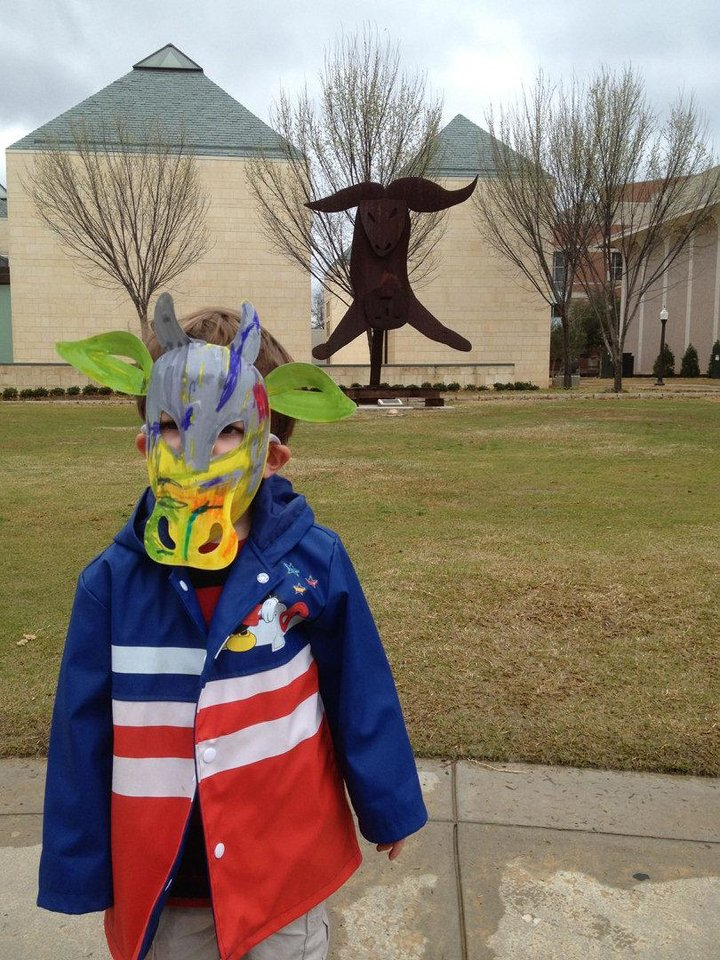 Photo - A local child wears a mask he created during a spring Family Day at the Fred Jones Jr. Museum of Art. The museum presents a free showing of the 1994 animated film, The Lion King, at10:30 a.m. Saturday, June 9, followed by a free Family Day 1-4 p.m. Sunday, June 10. Children must be accompanied by an adult. Photo provided.