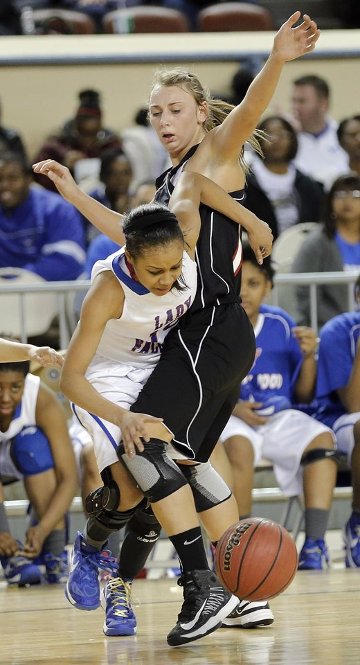 Photo - Verdigris' Courtney Risenhoover (14) defends on Millwood's Teanna Reid (10) during the 3A girls quarterfinals game between Millwood High School and Verdigris High School at the State Fair Arena on Thursday, March 7, 2013, in Oklahoma City, Okla. Photo by Chris Landsberger, The Oklahoman