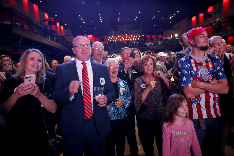 Photo - A crowd cheers as they watch election results during the Republican election night watch party watch party for the 2018 elections at the Bricktown Events Center in Oklahoma City, Nov. 6, 2018. Photo by Bryan Terry, The Oklahoman