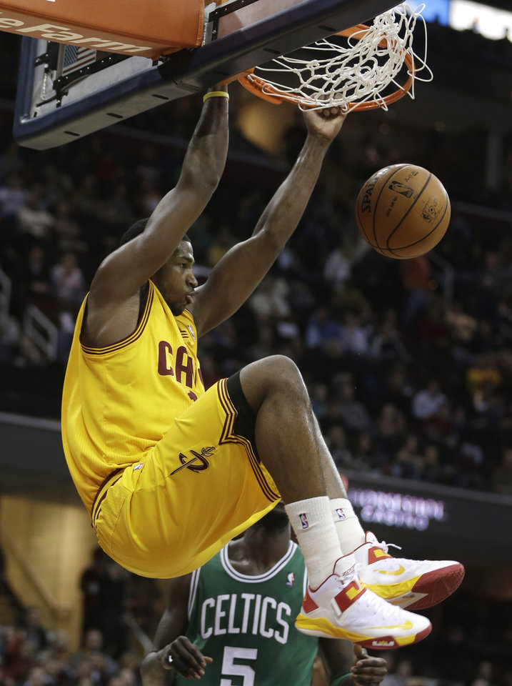 Cleveland Cavaliers' Tristan Thompson (13) dunks the ball against the Boston Celtics in the second quarter of an NBA basketball game Tuesday, Jan. 22, 2013, in Cleveland. (AP Photo/Tony Dejak)