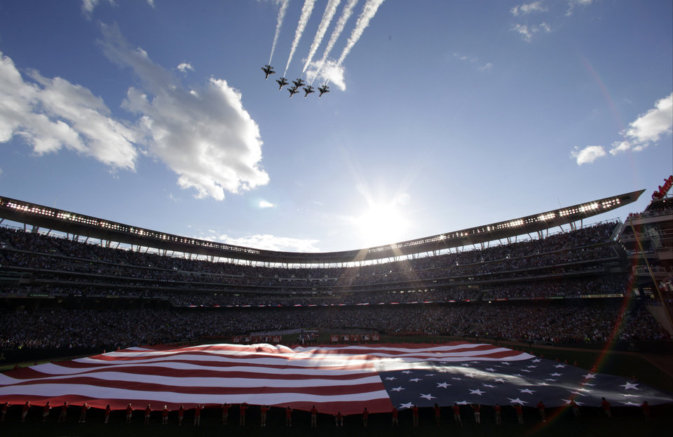Photo - The U.S. national anthem is played before the MLB All-Star baseball game, Tuesday, July 15, 2014, in Minneapolis. (AP Photo/Paul Sancya)
